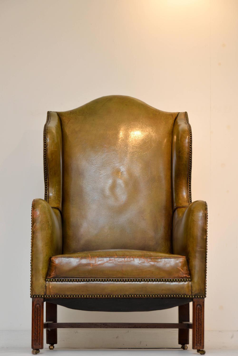 Vintage green leather wing chair for sale at 1stdibs for Leather wingback recliner sale
