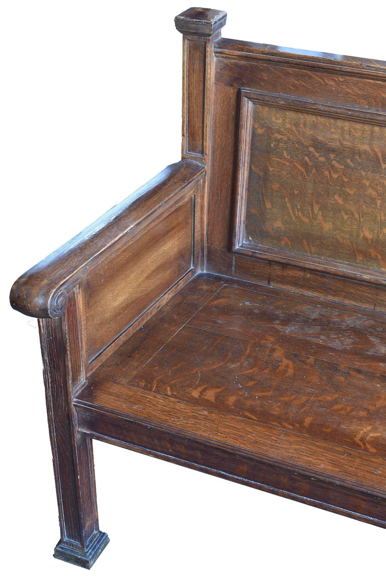 Beautifully chosen quartersawn oak makes this train station bench a seating piece of art. With its inlaid lines and a true craftsman style decorated with slightly flared ends makes this an easy to place and use antique architectural element.