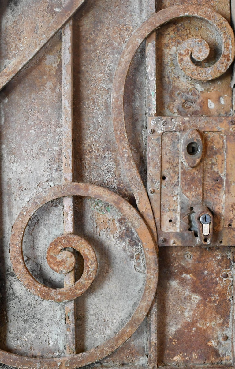 Arched Iron Door with Scrollwork, circa 1900 In Good Condition For Sale In Minneapolis, MN