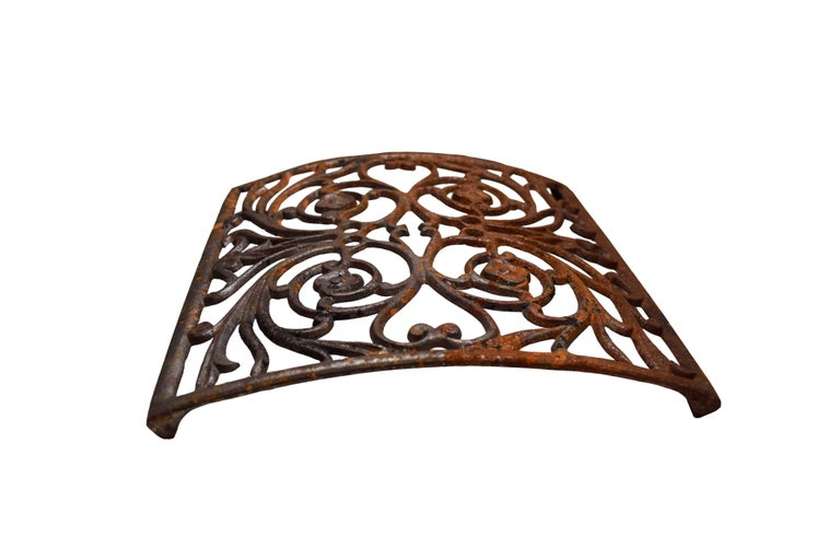 Early 20th Century Curved Iron Heat Grate with Floral Motif, Multiple Available For Sale