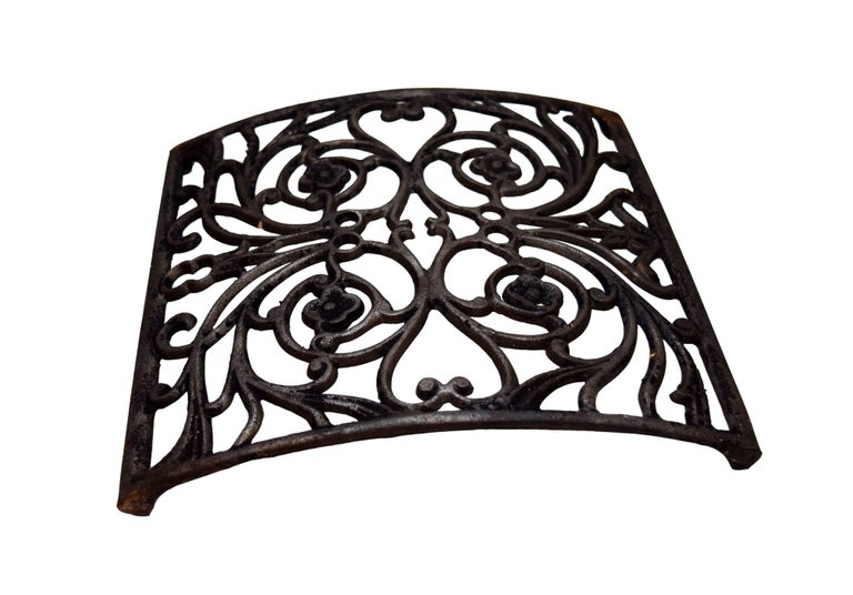 These curved heat grates all feature a symmetric, beautiful, curving, organic design throughout, made out of wonderful ironwork. There are 13 available, and while they all have the same patterning and design, they vary slightly in coloring &