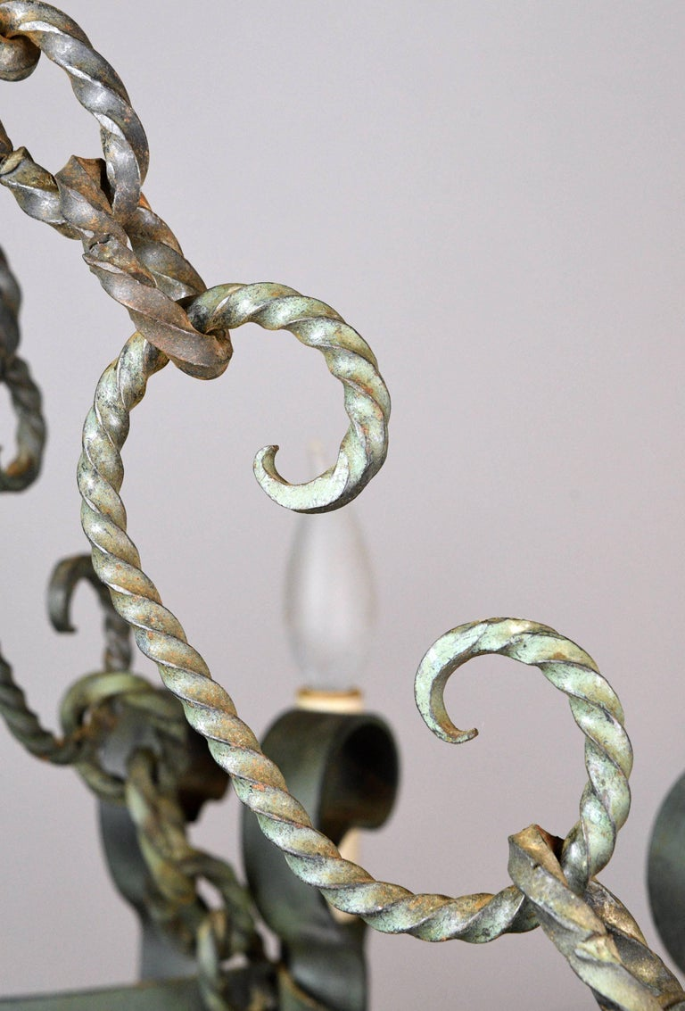 Early 20th Century Eight Candle Italianate Iron Chandelier For Sale