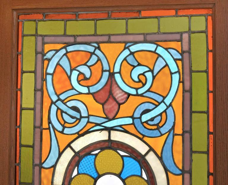 Victorian Teal and Amber Stained Glass Window with Rondelles In Good Condition For Sale In Minneapolis, MN