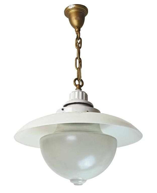This is a great Beardslee transitional fixture. As Industrial lights moved towards what is now considered the 'school house' style, glass was used to deflect light. This unique two-piece system includes the reflector shade and the opaque main shade,