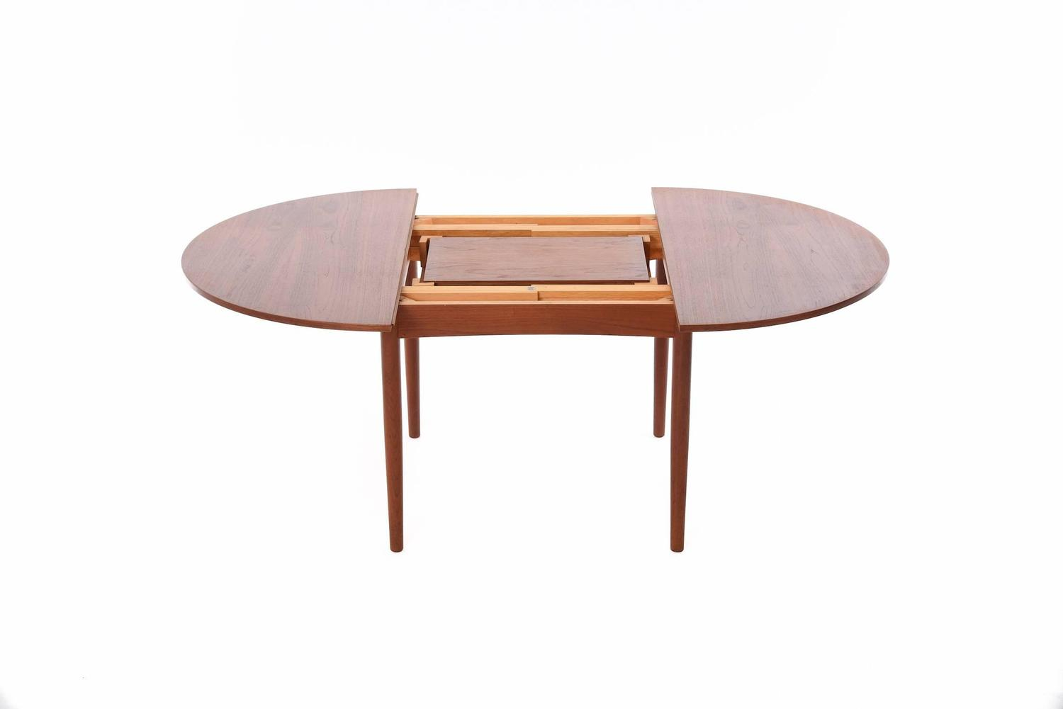 Danish modern dining table with self storing leaves at 1stdibs for Danish modern dining room table