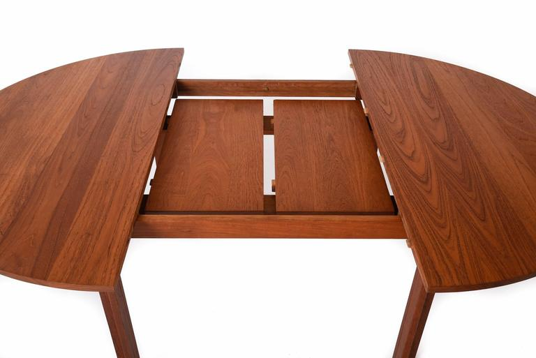 Danish modern round solid teak dining table with two for Solid wood round dining table with leaf