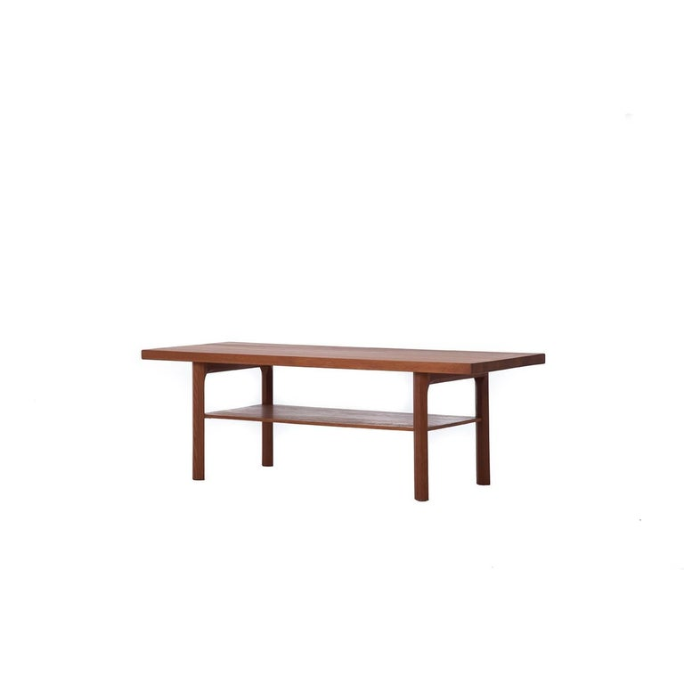 This Danish modern butcher block solid wood coffee table is a simple piece created from old growth teak. It is sturdy enough to be used as a bench. The wood is deeply luminescent and has a mid to dark tone. Hand finished in oil. Hexagon shaped legs
