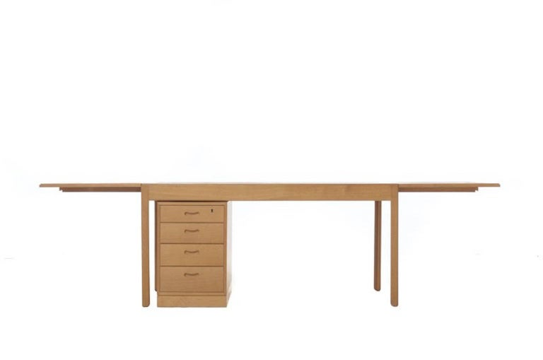 Beautifully restored, vintage, Danish modern drop-leaf desk in oak. Either or both drop leaves can be extended; file drawer cabinet is a stand-alone piece so can be placed to the left or right of the user.