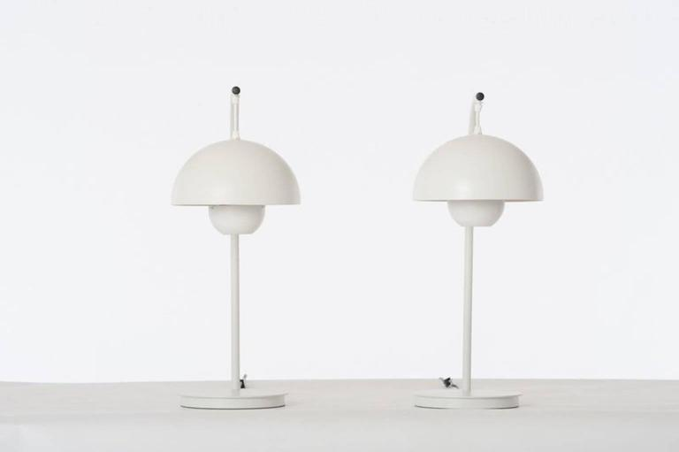 George Kovacs-designed table lamps in original, vintage condition. White aluminum with matte plastic shade. Pricing is for the pair.