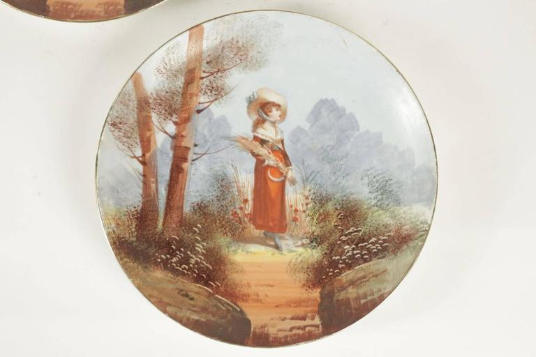 Pair of French porcelain hand-painted plates from the 19th century.
