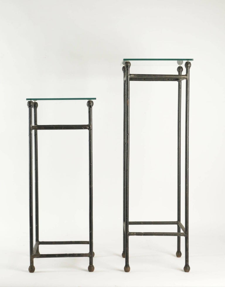 Two consoles in wrought iron under glass in an industrial style 20th century.