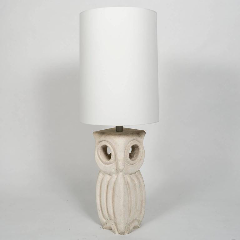 Lantern owl lamp sculpted in limestone by Albert Tormos in France during the 1970s and signed with initials AT. The lamp is electrified and has a white linen lampshade 21 inches tall and 16 inches in diameter. The owl measures 8 x 8 x 20 inches high
