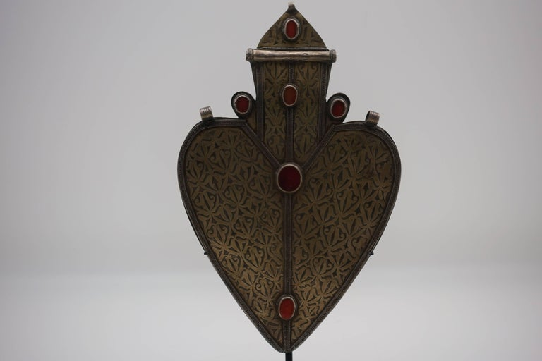 Large coin-silver Turkmen heart shaped pendant from Turkmenistan, boarding Afghanistan. Antique silver pendant from the early 1900s. Hand-tooled coin silver with six carnelian settings, mounted on a custom, black painted metal base.