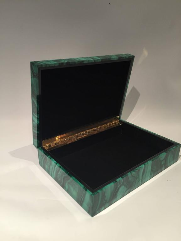 The malachite for this box was sourced from the Congo where the finest quality of this mineral is currently found. Malachite from the 18th and 19th century was also sourced from Russia.  Boxes, such as this, were typically brought back from Europe