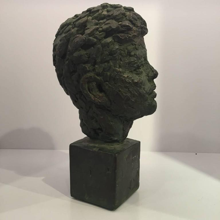 Bust of former President John Fitzgerald Kennedy made of bronze-patinated plaster by Robert Berks, American sculptor (1922-2011).