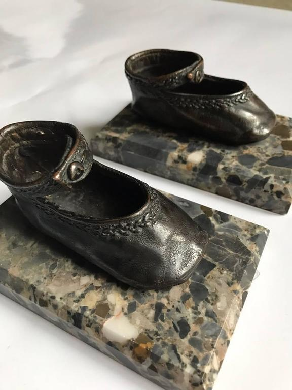 Beautiful and very unusual pair of early 20th century bronze ballerina style baby shoe paper weights mounted on marble bases.
