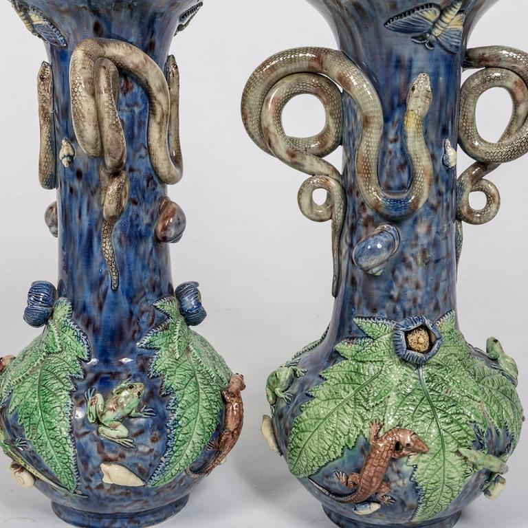 Beautiful pair of Majolica vase lamps with snake handles with frog, lizard, snail, butterfly and leaf decorations. The polychrome high relief detailing of the fauna and flora is of glazed and fired ceramic in the style of the 16th century French