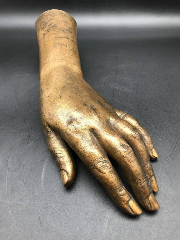 Detailed life-size French 19th century gilded bronze hand sculpture.