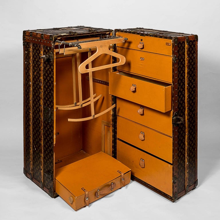 Louis Vuitton wardrobe trunk in monogram canvas; provenance the late Alexandra D. Gardiner Creel, owner of Gardiner's Island. Leather and brass bound, reinforced with wooden laths, the interior with hangers, dividers, a single drawer at the base of
