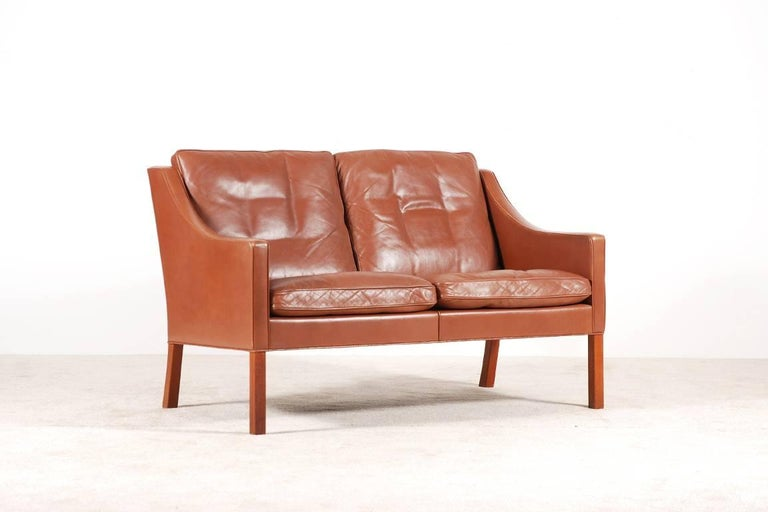 Lovely 2-seat sofa designed by Borge Mogensen in 1963. Model 2208 produced by Fredericia Stolefabrik in the 1960s. Original light brown leather and teak wood feet.