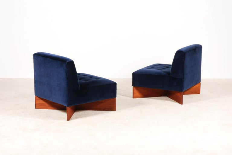 Pair of easy chairs model Capitole designed by the French designer Pierre Guariche. Minvielle edition, France, circa 1960. Base in teak veneer. Newly upholstered with a premium quality Raf Simons Velvet fabric by Kvadrat. Excellent