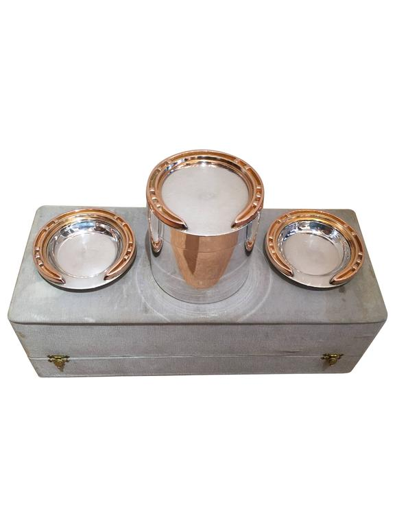 Truly a relic of a bygone era, this original Hermes silver and silver gilt smoker's set is circa the 1930s. All pieces are stamped