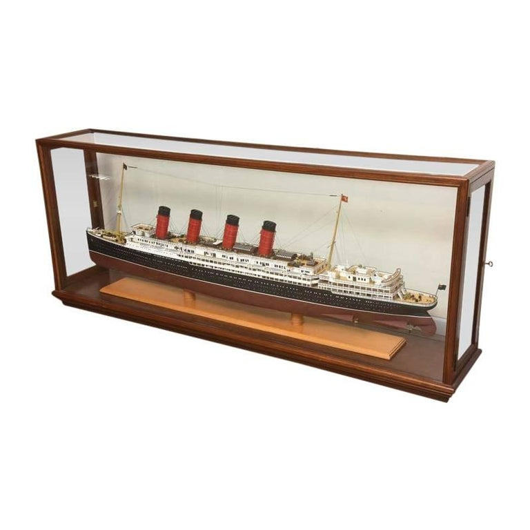 This large, detail model of the historic RMS Lusitania was hand built in the mid-20th century.  The Cunard line's RMS Lusitania was one of the most luxurious and esteemed passenger ships in the early 1900s. Its maiden voyage was on September 7th,