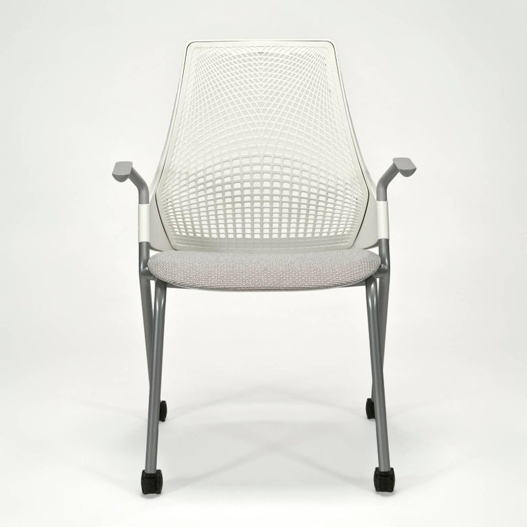 Six available -Brand new with original protective wrapping and consumer labels still attached. All chairs come with tilt lifter allowing adjustment to both tilt tension and range (four settings). These examples in studio white with fog upholstery.