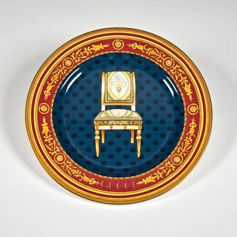 Porcelain with signature Gucci details including gilt gold tops, and gilt edging with gold rope motif and Gucci Vermillion accents. A fine gold line delineates the tops of the serving pieces and the edges of the plates. Side views of four different