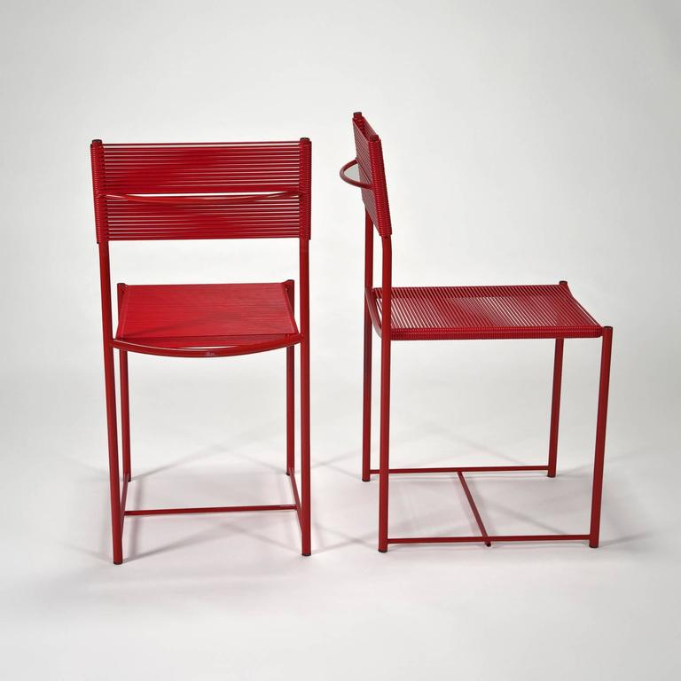 """Two available, all brand new with manufacturer hangtag in original carton. Made in Italy.   This chair was originally named the """"Odessa"""" chair, but was immediately renamed after exhibiting in New York. """"Spaghetti"""" refers to the"""