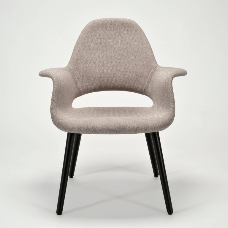 From recent production in very good condition. Upholstered in premium textile (Credo, Rock 12 colorway) in 95%wool & 5% Polyamide. Authentic Vitra tag on bottom.  This chair was originally designed in 1940 for the MoMA competition,