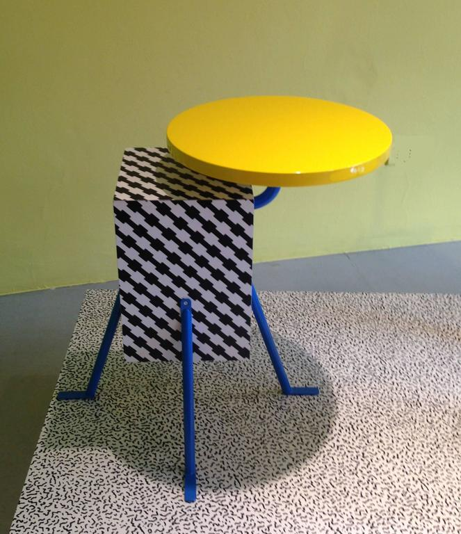 """From the inaugural 1981 Memphis collection, this very popular design by Michele De Lucchi (one of the founding members of the design collective) implements a De Lucchi laminate design named """"Terrific"""".  It is used on the base beneath its"""