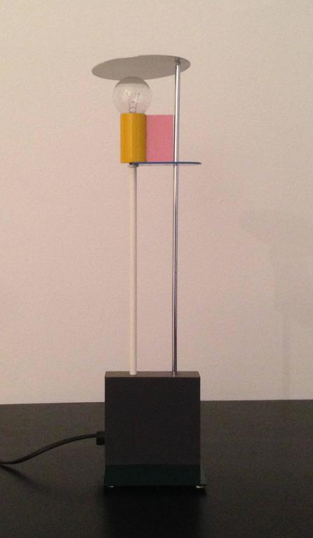 An early Memphis table lamp by Scottish Designer Gerard Taylor (of Sottsass Associate fame), from the 1982 Memphis exhibition. Uber-precise in its detailing, it has its apparent roots in De Stijl as well as Postmodernism.  Got a Rietveld Cassina