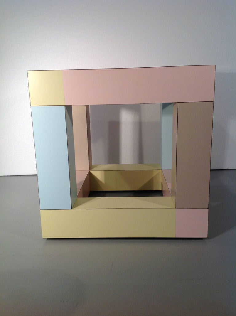 Mimosa end table by Ettore Sottsass for Memphis srl (1984)  A small end table in plastic laminates (different colors) with glass inset top / a perfect example of Sottsass's Masterly usage of color.
