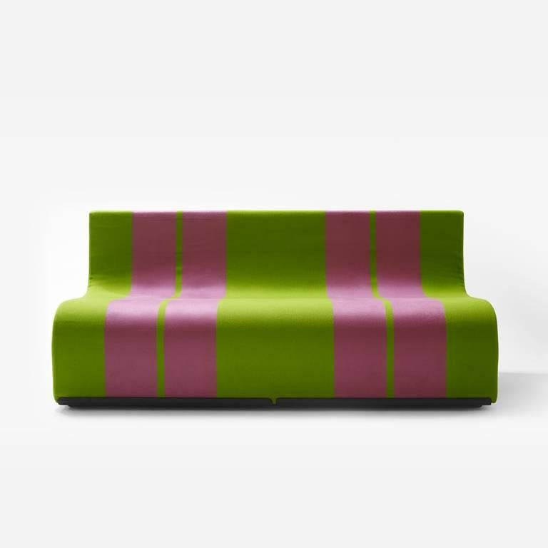 Sofo is a seat to place in a row, like a train, or to stack to build solid, colorful mountains. It is simply a block made with an S-shaped cut from a cube of polyurethane, covered with fabric featuring two large stripes. The result of a very simple