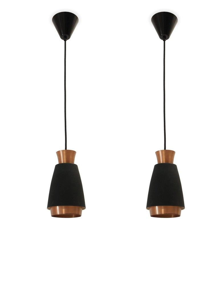 Wonderful pair of ceiling pendant in powder coated steel and copper.  Most likely designed and made in Norway from circa 1960s second half.  Both lamps are fully working and in excellent vintage condition.  Wire length 85cm.