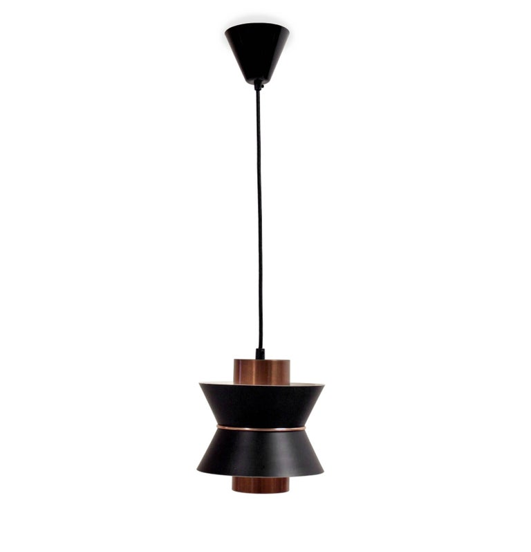 Decorative and light ceiling pendant in painted steel and copper. Most likely designed and made in Norway by TR&CO from circa 1960s second half. The lamp is fully working and in excellent vintage condition.