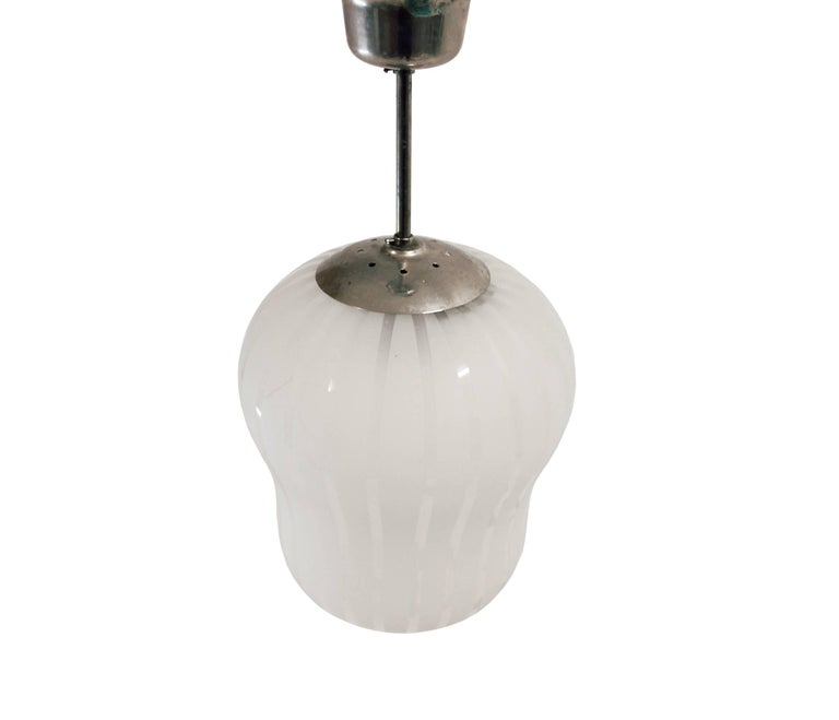 Wonderful ceiling lamp in handblown glass. Designed by Gunnel Nyman and made in Sweden by Orrefors from circa 1950s first half. The lamp is fully working and in good vintage condition.