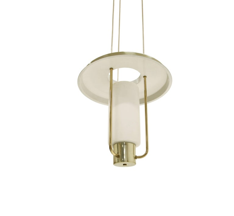 Refreshing and expressive ceiling lamp on a brass frame and shade in opaline glass shade. This is model 'T-825'. Designed and made by Hans Agne Jakobsson in Sweden from, circa 1960s second half.