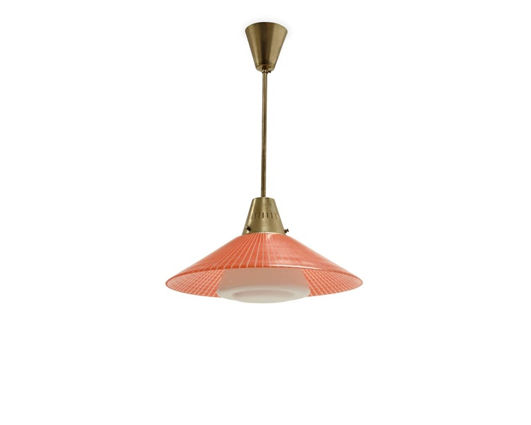 Wonderful and well-made ceiling light on a brass frame, surface decorated glass shade and opaline glass cupola. Designed and made in Norway by Tr & Co (T. Røste), circa 1960s second half. The lamp is fully working and in very vintage condition.