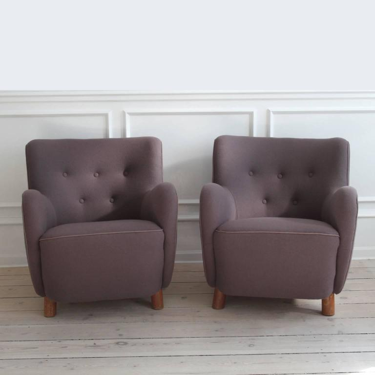MOGENS LASSEN - MID-CENTURY MODERN DESIGN / SCANDINAVIAN MODERN  A pair of easy chairs by the iconic Danish architect and designer Mogens Lassen, Denmark, 1940s   Upholstered in dusty purple colored fabric by Kvadrat, the leading fabric manufacturer