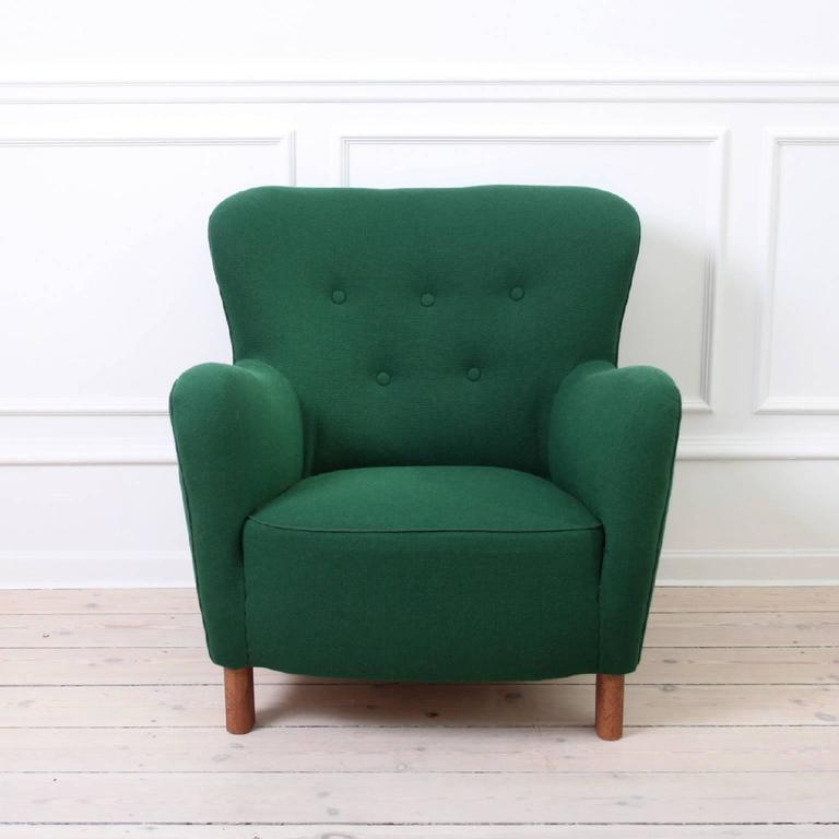 FTITZ HANSEN - SCANDINAVIAN MODERN  The iconic pair of easy chairs from Fritz Hansen, model 1669.   Upholstered in green wool fabric by the reknowned Kvadrat.   Legs of stained beech  Manufactured by Fritz Hansen, circa 1940.  Excellent