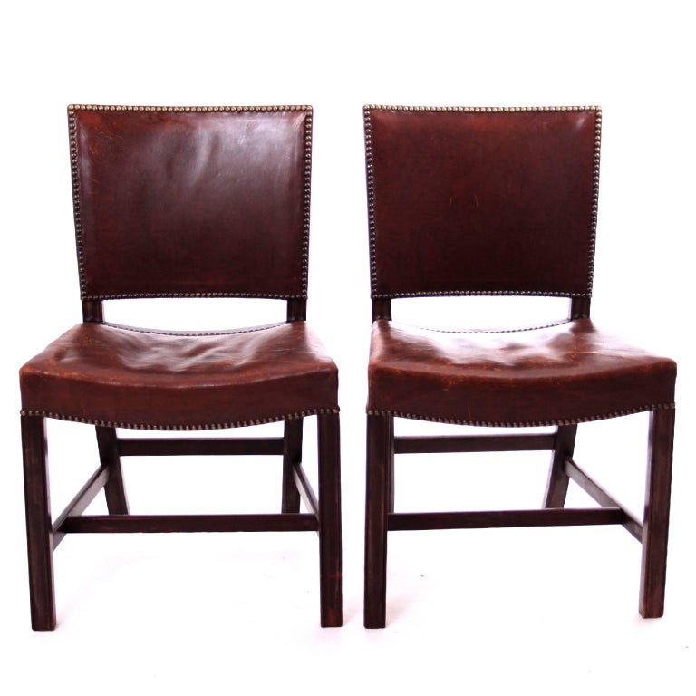KAARE KLINT & CABINETMAKER RUD RASMUSSEN - SCANDINAVIAN MODERN  A set of two iconic Kaare Klint 'Red Chairs', executed by cabinetmaker Rud. Rasmussen, Denmark, 1930s.   Profiled legs and seat and back upholstered with patinated brown leather and