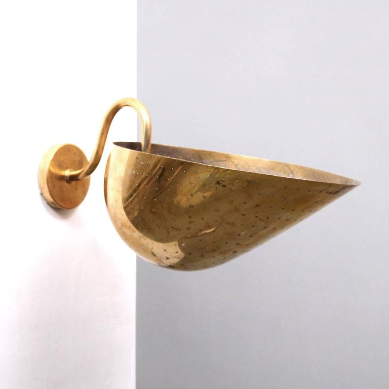 CARL-AXEL ACKING & BRODERNA - SCANDINAVIAN MODERN   A rare sculptural wall light designed by Carl Axel Acking, a reknowned Swedish architect, auther and furniture designer.   Manufactured by Bröderna Malmströms Metallvarufabrik, Sweden,