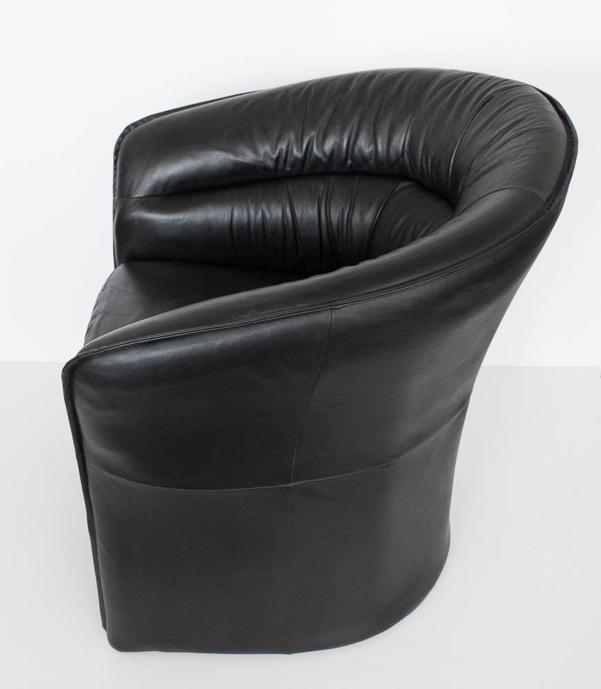 Modern black faux leather armchair at 1stdibs