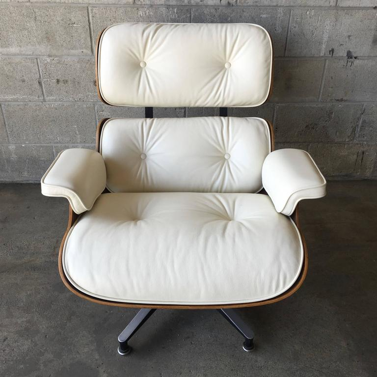 Herman Miller Eames lounge set. Lounge chair and ottoman in Brazilian rosewood and cream leather. Cushions are new. The rosewood shells are professionally refinished. These cushions are made to order and require a 2 week production time.