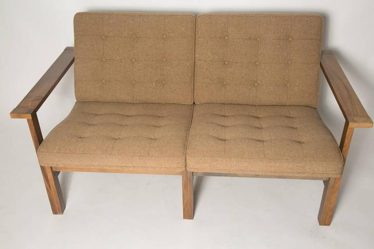 The iconic moduline sofa designed by Ole Gjerløv-Knudsen & Torben Lind for France & Son, Denmark, 1960. This sofa has a solid rosewood frame and flawless wool covered seats.