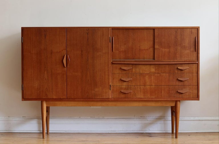 Mid-Century Modern Danish tall teakwood credenza.