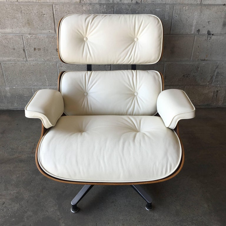 Rosewood Herman Miller Eames lounge chair and new ivory cushions. In perfect condition. Impeccable rosewood color and grain detail. A second chair with ottoman is also available.