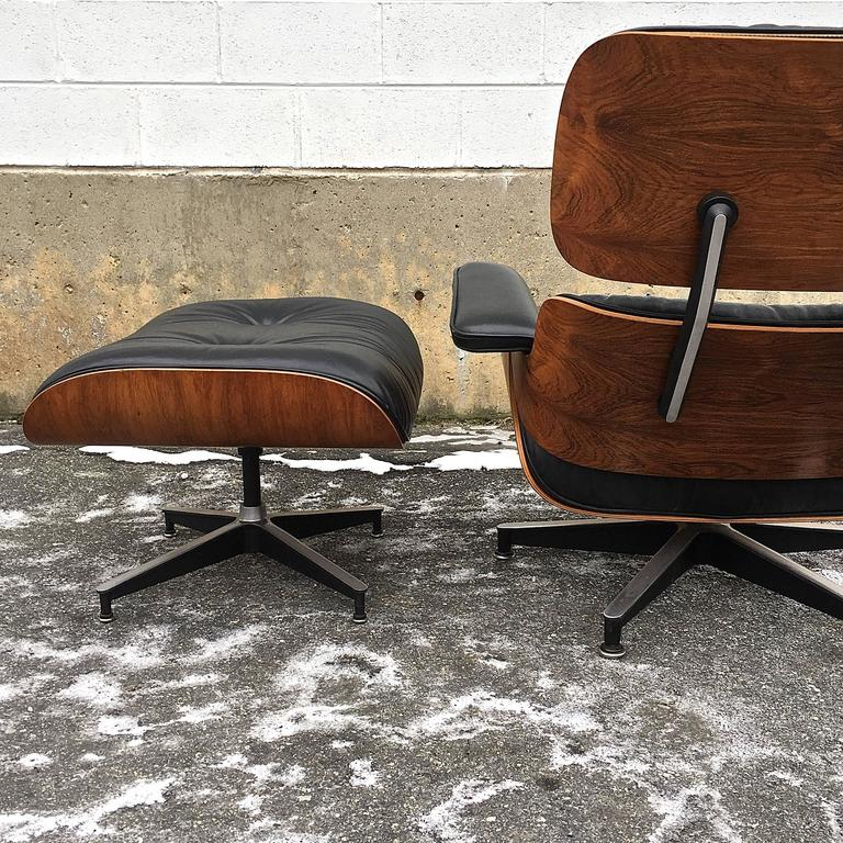 Herman Miller Eames lounge and ottoman in Brazilian rosewood. Chair marked May 7, 1975. All original. Leather in very good condition and rosewood shells boast lovely patina and color.